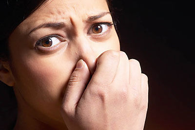 1-woman-pinching-nose-and-covering-mouth-uid-14263201-1405410354710.jpg